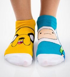 Adventure Time Socks... I have some of these, not exactly, but I have Finn, Jake, Marceline, Beemo, Ice King, and Princess Bubblegum. I wear them to school occasionally. -BE PROUD-