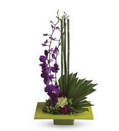 Zen Artistry - T81-1A ($47.66) - It's artistic arrangements like this one that make flowers such an integral and beautiful ingredient in feng shui. A brilliant green container and exotic palm leaf provide the perfect backdrop for purple orchids and a mix of delightful tropical flowers.