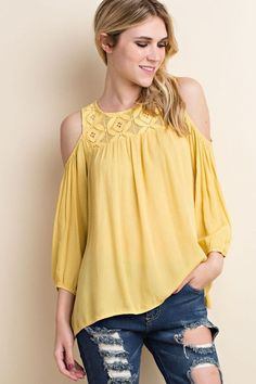 Gorgeous Yellow Top perfect for Spring. Pair with a pair of skinny jeans and wedges for the perfect Spring Look Light Mustard Yellow Cold Shoulder Top Lace Detail on Neckline and Back 100% Rayon Runs