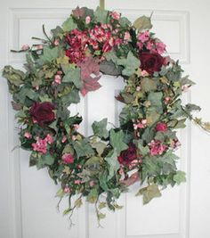 Red and pink silk roses generously decorate the faux ivy on this Rhapsody Floral Wreath . This wreath is made on a sturdy base of natural twigs. Silk Roses, Silk Flowers, Silk Arrangements, Country Wreaths, Welcome Wreath, Door Wreaths, Spring Wreaths, Red Silk, Pink Silk