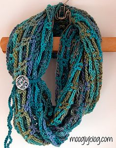 The Artfully Simple Infinity Scarf pattern is super easy, hides a multitude of sins, and comes with just one rule: no stress allowed! This finished scarf is between 50 and 60 inches long, and twists and turns on itself naturally – perfect for wearing doubled as a cowl, as well as long, tied, anything you can come up with! The little button tie embellishment is a separate optional piece, and instructions for that are included as well!