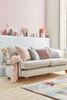 Be creative by mixing and matching colours and fabrics against soft pastels and dusky grey colour schemes. Pictured: Bluebell two and a half seat sofa in taupe, sofa.com. Find more ideas at housebeautiful.co.uk