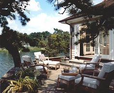 Pretty terrace with comfortable seating overlooking the lake