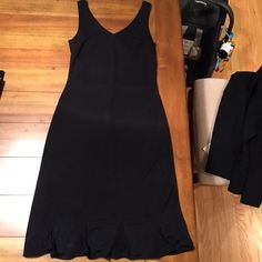 Little Black Dress Brand new, never worn! Adorable little black dress. Hits below the knee. This is a petite size Ann Taylor Dresses