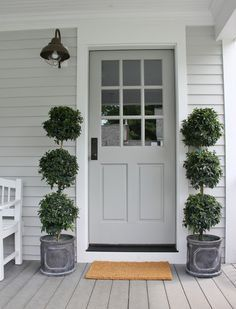 Welcome friends and family to your home with a soft, subtle Colonial Revival Gray SW 2832 door.