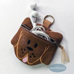 Coco Puppy Dog Coin Purse / Ear Bud Pouch: Here's Coco, a coin purse shaped like a puppy dog face,paw-fect for carrying spare change, ear buds, and other small items like rings or jewelry.   SewAmazin @sewamazin #doglovers #handmade #indiemade