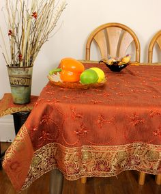 Colorful hand embroidered tablecloth for a Halloween party