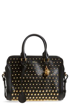 Textured, gradient-scale studs and a signature skull padlock add fierce modern edge to a standout McQueen handbag. Top carry handles and an optional crossbody strap bring effortless versatility to the impeccable design.