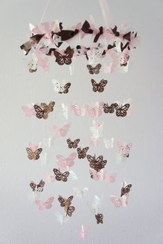 Polka Dot Nursery Mobile- Butterflies in Pink, White, & Chocolate- Nursery Decor, Baby Shower Gift. $63.00, via Etsy.