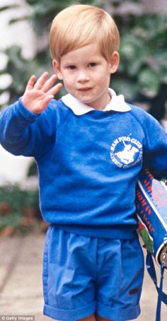 Pictured, Prince Harry waves to camera on his first day of nursery school in west London's Notting Hill