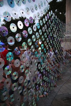 As digital music continues to thrive, CDs are more and more a thing of the past. For the architects of Ignatov Architects, though, the little round discs were the perfect medium for this art project, entitled Mirror Culture. For the interactive installation, the team, along with 128 volunteers, invited residents and visitors of Varna in Bulgaria to help mount more than 6,000 used CDs onto knitted fishing net. The metallic reflections created a bright and captivating installation that hung…