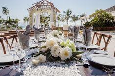 Beautiful reception centerpiece from a wedding held here at Secrets Vallarta Bay Puerto Vallarta! #DestinationWedding #SecretsVallartaBay #Centerpiece
