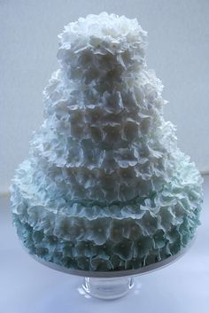 Four-tier, blue-and-white sugar blossom #wedding #cake reminiscent of gently falling snow.