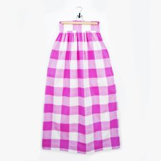 This Holiday our Magenta Gingham Maxi skirt is a must have. The wide waistband on this skirt, paired with the long length make it both dramatic and interesting. Pair with flat sandals for a casual outing or with heels and a crisp white shirt to dress it up.
