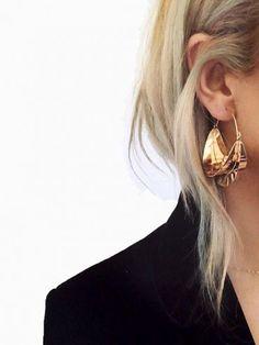 En cette période de fêtes, on use et abuse des boucles d'oreilles