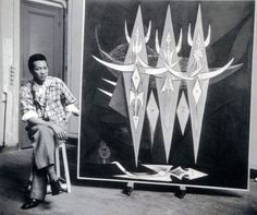 Wifredo Lam with his work Threshold • Newly settled in his native land after almost twenty years, Lam delved deeper into his artistic investigations, finding nourishment for his ideas in the surroundings of his childhood and youth. His sister Eloisa, whom he was closest to, explained to him in much detail the workings of Afro-Cuban rituals and he began attending ritual ceremonies with some of his friends. This contact with Afro-Cuban culture brought new impetus to his art.