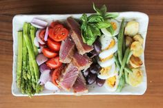 Nicoise 500g fresh tuna, seared and sliced 250g green beans, stems chopped off 250g asparagus, skinned chopped off Handful of black olives 1 cup cherry tomatoes, cut in half 1 cup baby potatoes ¼ cup good quality olive oil ½ cup lemon juice 2 tbsp light honey 1 tsp oregano Pinch of salt Preparation Prepare the tuna to your liking. Just dab a touch of oil on the pan and make sure it's very hot.