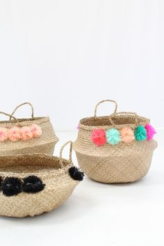 "Eliza Grand Ojai basket, Low straw basket with colorful pom poms. 2 handles & aprox. 18"" X 9"" Baskets are handmade and one of a kind."