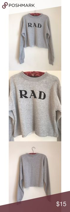 """Brandy Melville RAD Sweatshirt Light heather grey cropped sweatshirt. Features """"RAD"""" graphic in black velvet across the chest. Super soft, and easy to wear.  Brand is Brandy Melville, but the tag has been cut out.   Item Details: Brand: Brandy Melville Size: Small Condition: Like New (never been worn, no visible flaws)  Seller Details: Items ship within 48 hours All orders come with a free gift Reasonable offers accepted Save more with bundles If you have any questions just ask :) Brandy…"""