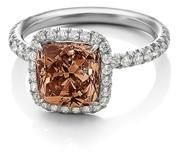 brown diamond engagement ring. love the diamond color. would change the setting.