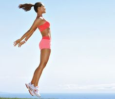 JIGGLE-FREE JUMP    Squat with arms extended in front of you at shoulder height, palms down. Jump up, throwing arms behind you (as shown), then land in squat position. Repeat 20 times without rest.