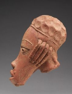 Head, 600 BC-AD 250 Guinea Coast, Nigeria, Nok region, 7th century BC-3rd century AD terracotta, Overall - h:38.20 w:20.00 cm (h:15 w:7 13/16 inches). Andrew R. and Martha Holden Jennings Fund 1995.21