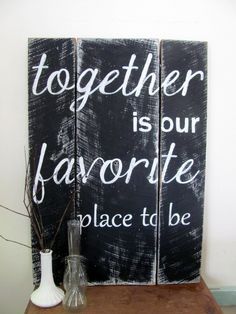 """Black, hand painted, distressed, wooden sign """"together is our favorite place to be. $48.00, via Etsy."""