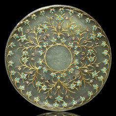 A diamond and turquoise-inset and gold-inlaid pale jade saucer. India, circa 1900. Photo: Christie's Images Ltd 2010. Of shallow form with raised lip, the interior with a vacant central circle surrounded by lobed border issuing turquoise-inlaid palmettes, beyond these a series of floral sprays issuing similar palmettes and diamond-inset leaves, the edge with similar lobed border, in fitted box; 5½in. (14cm.) diam