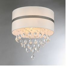 Warehouse of Tiffany Paul 4 Light Crystal Drum Chandelier This is my second choice for the two foyer lights. It has a smaller diameter and is a little less dramatic than the all-crystal fixture.