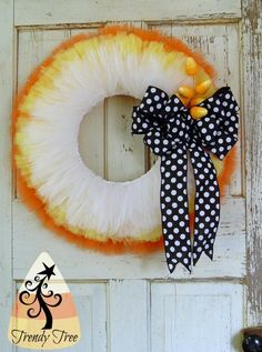 Candy Corn Wreath Tutorial Trendy Tree tutorial for making a Candy Corn Wreath for Halloween using a wreath frame, Tulle, ribbon and Candy Corn picks. Tulle Crafts, Wreath Crafts, Diy Wreath, Wreath Ideas, Wreath Making, Fall Tulle Wreath, Ribbon Making, Garland Ideas, Diy Crafts