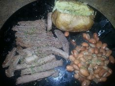Montreal round steak with baked potato and beans.