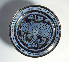 Plate Iran Plate, 12th century Ceramic; Vessel, Fritware, luster painted over a blue glaze, Height: 1 3/8 in . (3.5 cm ); Diameter: 7 in . (17.8 cm ) The Nasli M. Heeramaneck Collection, gift of Joan Palevsky (M.73.5.288) Art of the Middle East: Islamic Department.