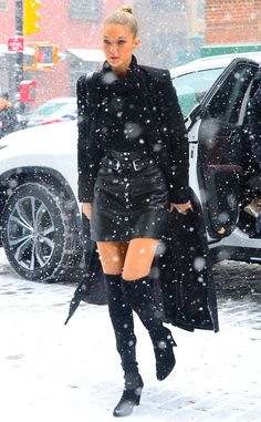 <p>Gigi slays under the snowflakes as she seduces us in her favorite boots and black mini skirt.</p>
