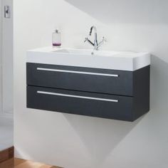 Shop the Relax Wall Mounted Basin & Cabinet online and transform your modern bathroom. Features a smooth Black Wood finish. At Victorian Plumbing now. Small Bathroom Cabinets, Wood Bathroom, Laundry In Bathroom, Bathroom Furniture, Downstairs Cloakroom, Bathroom Vanities, Cheap Bathroom Suites, Big Bathrooms, Wood Vanity