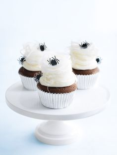 Halloween Cobweb Cupcakes with cotton candy toppers
