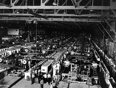 June 23, 1943: At the Lockheed Aircraft Corp. plant in Burbank, three new mechanized conveyor lines help double the production of the P-38 Lightning, an advanced high-altitude fighter plane.    The new assembly lines were built in nine days. During the change-over, the old assembly line moved outdoors. Production of P-38s never stopped.