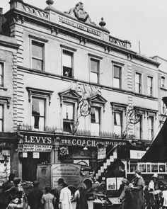Coach & Horses, Notting Hill Gate. Once a well-known old coaching inn, it still carries on the tradition with motor coaches.