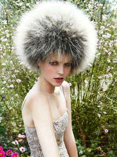 I hope that is a hat because if not I cannot imagine wanting to look like a full blown head of dandelion seeds!