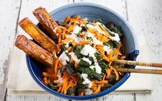 On a bed of rice sits braised kale, oven-baked tofu, juicy sautéed mushrooms, and crunchy carrots, drizzled with homemade ranch dressing.