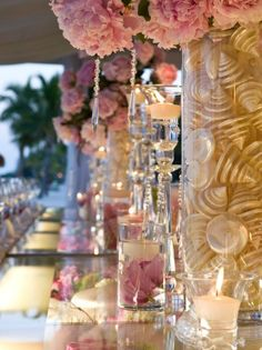 Flowers and shells in water give your tall centerpieces a timeless and special look for your beach wedding. Tweet Preston at: @Preston Bailey Friend Preston on Facebook at: Preston Bailey.