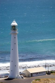 Slangkop lighthouse constructed in but first lit only in 1919 after World War I, this high lighthouse is located near Kommetjie, a suburb of Cape Town in South Africa. Lighthouse Pictures, Beacon Of Light, Light Of The World, Exotic Places, World's Most Beautiful, Places To See, Around The Worlds, Ocean, Building