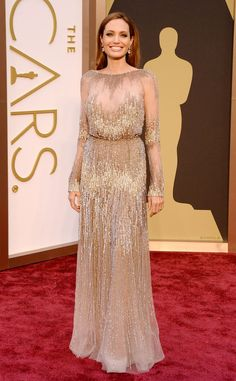 ANGELINA JOLIE As if she needed any more help stealing the red carpet spotlight, the actress literally shined in a shimmer Elie Saab Haute C...