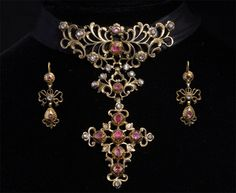 Diamond and Ruby Demi-parure, ca. 1750-1760, diamonds, rubies, gold, silver, The pendant necklace is made diamonds and rubies mounted vermeil (silver gilt)  and worn on a ribbon, pendant: 93 x 68 mm,  earrings: 38 x 16 mm