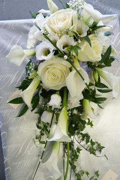 Bridal shower/teardrop bouquet of white calla lilies, avalanche roses,lissianthus and ivy foliage