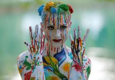 A model poses during the World Bodypainting Festival in Poertschach, Austria, July 1, 2016. - REUTERS/Heinz-Peter Bader