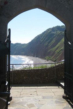 A glimpse of Jacob's Ladder beach from the Connaught Gardens, Sidmouth | South Devon | England