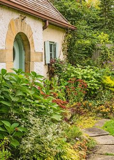 Plan ahead for fall beauty! Ornamental grass 'All Gold', creeping Jenny 'Aurea' and juniper 'Eternal Gold' carry bold yellow through this Ohio garden. More plant suggestions: http://www.midwestliving.com/garden/featured-gardens/garden-tour-three-part-harmony/?page=16