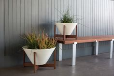 A mid-century inspired high-fire ceramic stoneware planter, designed to be used indoors or out. Blurring the lines between exterior and interior spaces, these sculptural planters are a great way to showcase your favorite botanicals. Made from high-fire stoneware and glazed in a matte finish, these planters can withstand the elements outdoors (above freezing), but are …