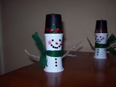 The snowman was easy. It took 2 white k-cups and 1 black. I hot glued them together and decorated them. You might want to use a cold glue gun for the features, or Sharpies work too. The hot glue came...
