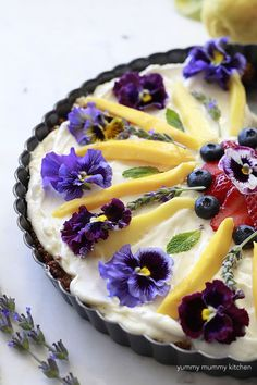fruit and granola tart for breakfast with edible flowers